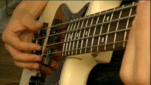 thumb muting on bass guitar